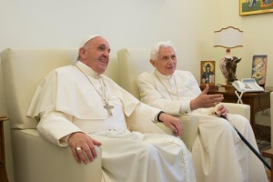 Pope Francis chats with retired Pope Benedict XVI at the retired pope's home at the Mater Ecclesiae monastery at the Vatican June 30. (CNS photo/L'Osservatore Romano) See SUMMER-POPES June 30, 2015.